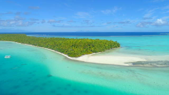 vidéos et rushes de aerial drone view of scenic tropical islands in french polynesia. - lagon