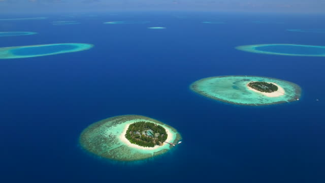 aerial drone view of scenic tropical islands in the maldives. - indian ocean stock videos & royalty-free footage