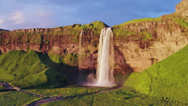 vídeos y material grabado en eventos de stock de aerial drone view of seljalandsfoss waterfall at sunset, iceland - punto de referencia natural