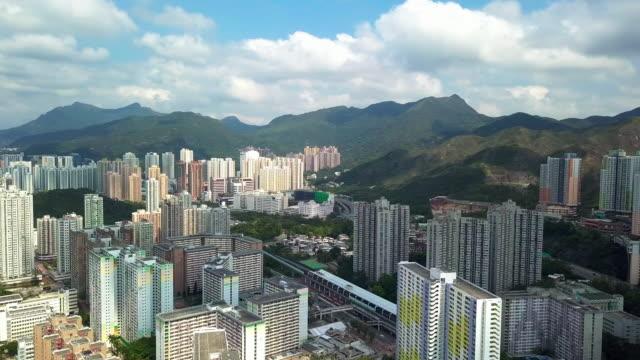 stockvideo's en b-roll-footage met luchtfoto drone view van sha tin district met vissen mun rivier - hong kong