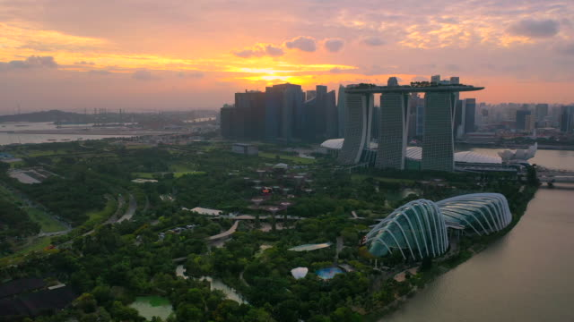 aerial drone view of singapore skyline in sunset scene - bay of water stock videos & royalty-free footage