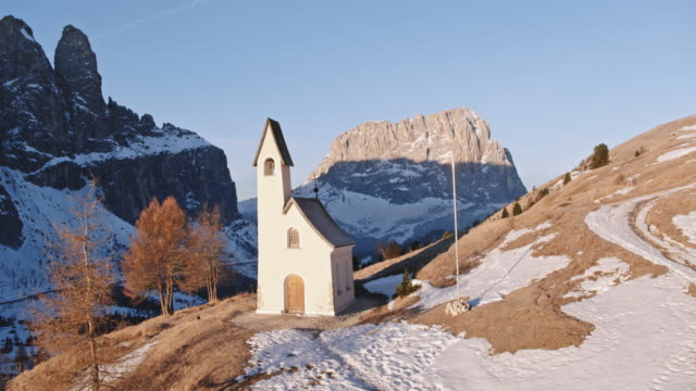 Aerial drone view of small church in the italian alps, Dolomites, Italy