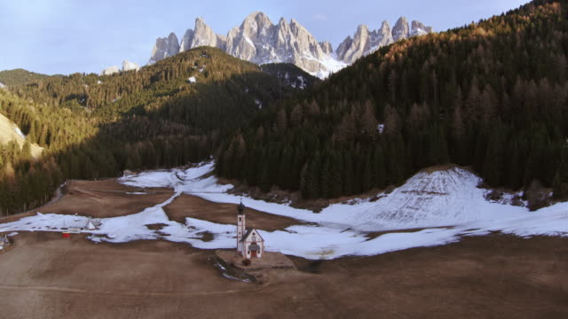 aerial drone view of small church with mountain peaks, dolomites, italy - trentino alto adige stock videos & royalty-free footage