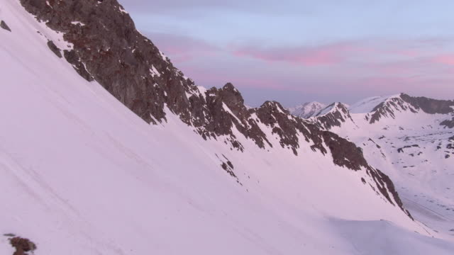 aerial drone view of snow mountains in golden hour - twilight stock videos & royalty-free footage