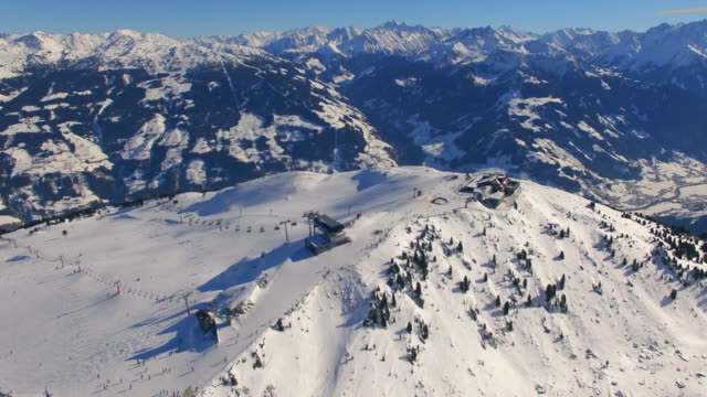 aerial drone view of snow mountains in winter at a ski resort. - 北チロル点の映像素材/bロール
