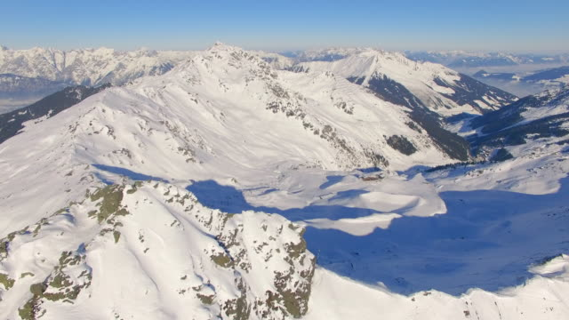 aerial drone view of snow mountains in winter. - austria stock videos & royalty-free footage