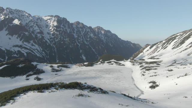 aerial drone view of snowy mountains - snowcapped mountain stock videos & royalty-free footage