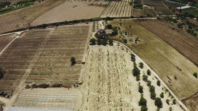 aerial drone view of some ruins in a dry land in sicily v.2 - mediterranean sea stock videos & royalty-free footage