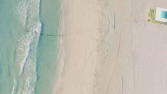aerial drone view of south beach lifeguard tower and beach, miami, florida at sunrise - アールデコ地区点の映像素材/bロール