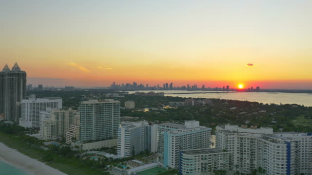 aerial drone view of south beach, miami, florida, united states, usa at sunset. - time-lapse - south beach stock videos & royalty-free footage