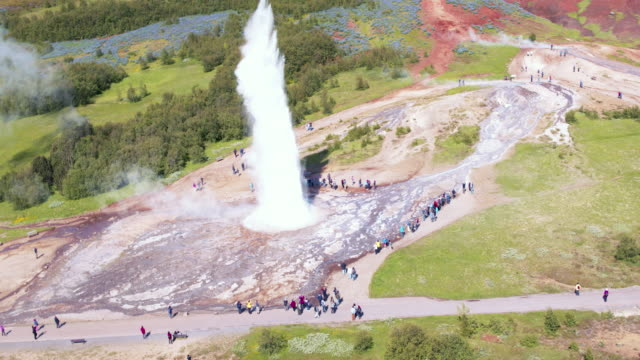 aerial drone view of strokkur geyser erupting, geysir, iceland - geyser stock videos & royalty-free footage