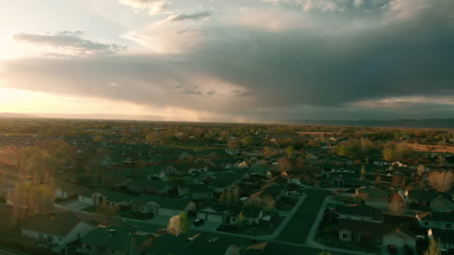 aerial drone view of subdivisions in the grand valley at sunset, snowy grand mesa, book cliffs - colorado stock videos & royalty-free footage