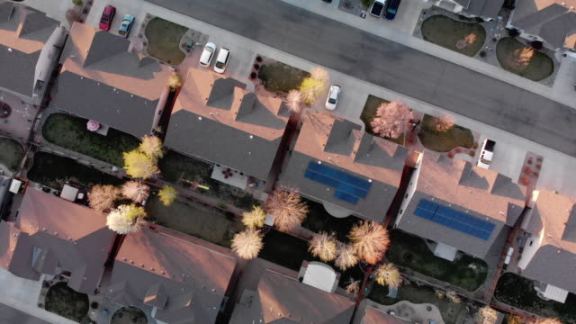 aerial drone view of subdivisions in the grand valley at sunset, snowy grand mesa, book cliffs - roof stock videos & royalty-free footage