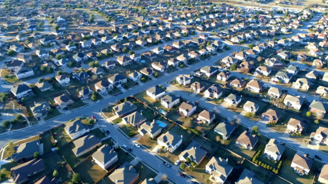 aerial drone view of suburb neighborhood with perfect little boxes of houses in perfect rows - texas stock videos and b-roll footage