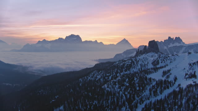 aerial drone view of sunrise over mist filled valley with mountain peaks - european alps stock videos & royalty-free footage