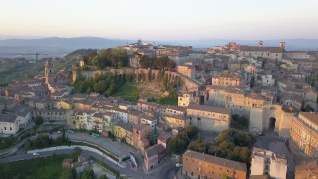 aerial drone view of sunset and the village town of perugia, tuscany, italy. - perugia stock videos & royalty-free footage