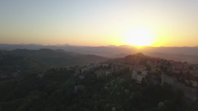 aerial drone view of sunset and the village town of perugia, tuscany, italy. - spirituality stock videos & royalty-free footage