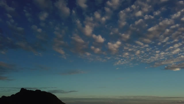 stockvideo's en b-roll-footage met aerial drone view of sunset, mountain and sky with clouds - huahine