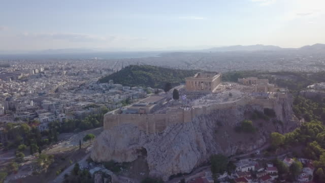 aerial drone view of the acropolis and parthenon, athens, greece. - acropolis athens stock videos & royalty-free footage
