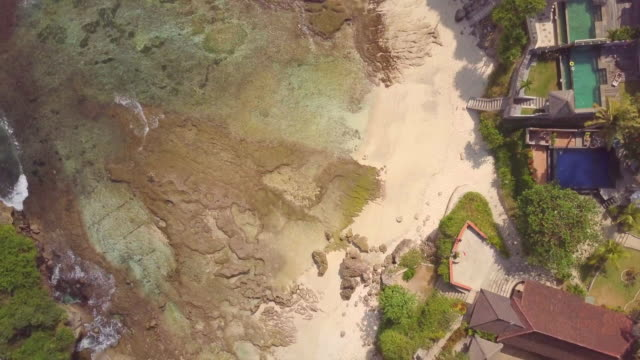 aerial drone view of the beach at mahana point, bali, indonesia. - bali stock videos & royalty-free footage