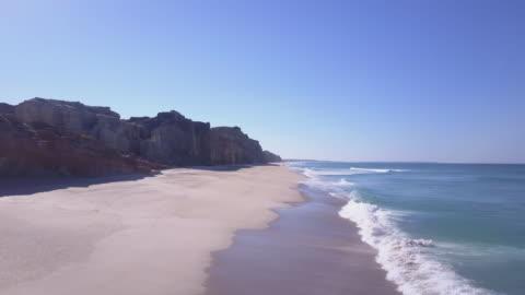 stockvideo's en b-roll-footage met aerial drone view of the beach ocean coastline waves sea. - time-lapse - klif