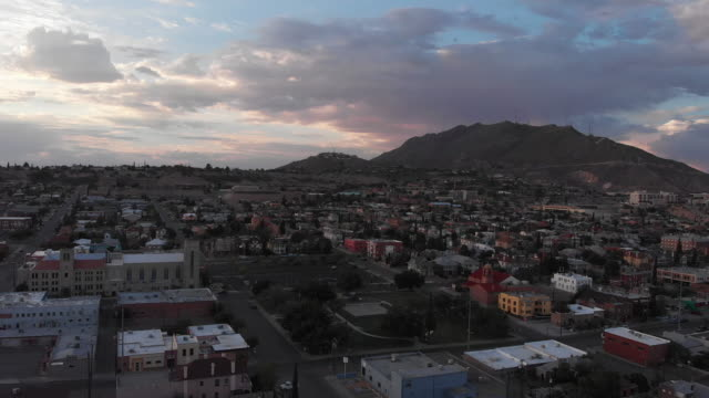 aerial drone view of the el paso city skyline at sunset - el paso texas stock videos & royalty-free footage