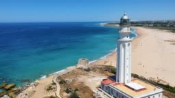 Aerial drone view of the faro de Cabo Trafalgar, a lighthouse at Cape Trafalgar, a headland in the Province of Cadiz in Andalusia, Spain. The 1805 naval Battle of Trafalgar took place off the cape.