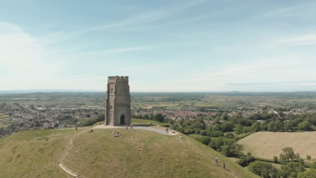 aerial drone view of the glastonbury tor & st michael's tower, an ancient monument steeped in legend and mythology atop a hill in glastonbury,... - glastonbury tor stock videos & royalty-free footage