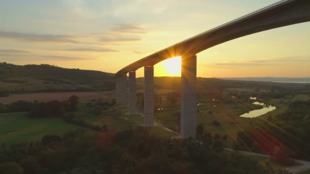 aerial drone view of the m7 motorway highway viaduct bridge near koroshegy, hungary at sunset. - time-lapse - hungary stock videos & royalty-free footage