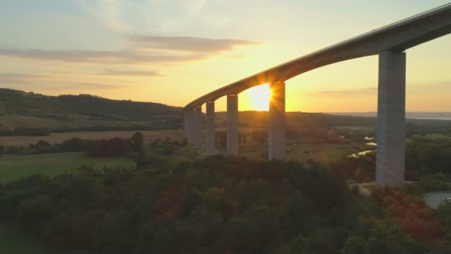 aerial drone view of the m7 motorway highway viaduct bridge near koroshegy, hungary at sunset. - time-lapse - viaduct stock videos & royalty-free footage