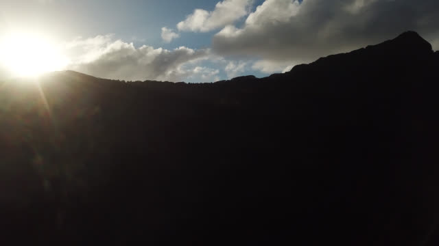 stockvideo's en b-roll-footage met aerial drone view of the mountain in daylight with the sun - huahine