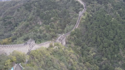 aerial drone view of the mutianyu section of the great wall of china. - mutianyu stock videos & royalty-free footage