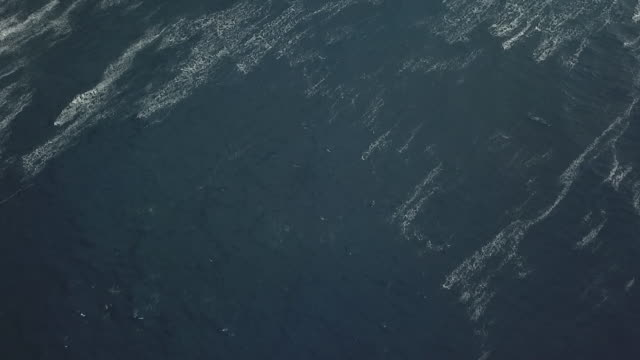 vidéos et rushes de aerial drone view of the sea with waves and foam - south pacific ocean