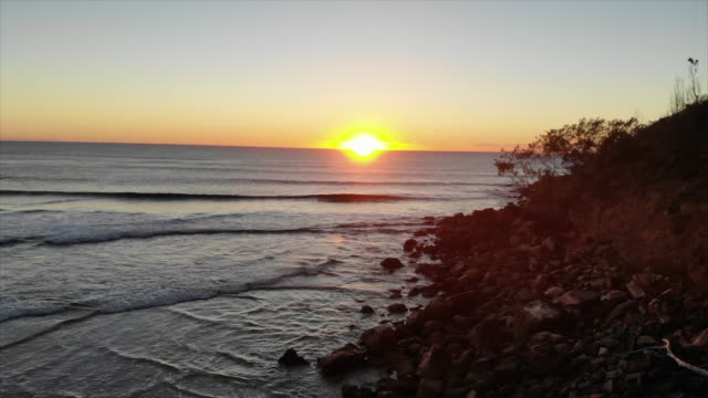 aerial drone view of the surf and waves at the beach at sunset. - slow motion - new south wales stock videos & royalty-free footage