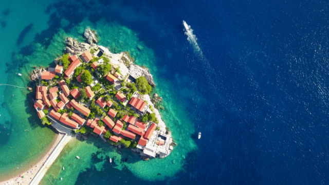 Aerial drone view of town village of semi island Sveti Stefan in Montenegro.