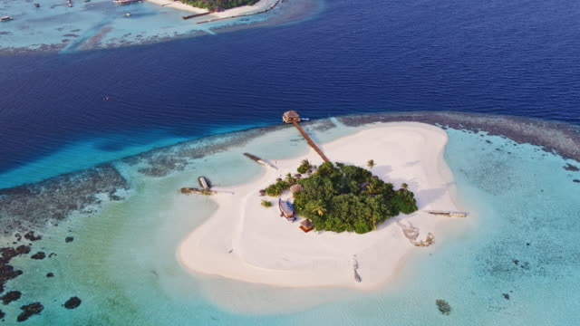 aerial drone view of tropical island and sea, maldives - ari atoll stock videos & royalty-free footage