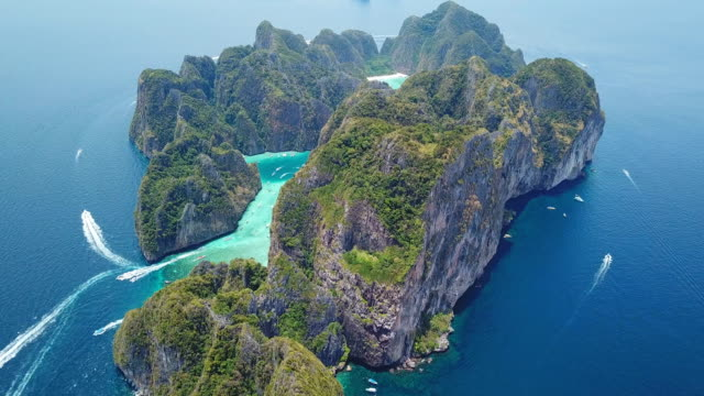 aerial drone view of tropical maya bay and limestone cliffs, phi phi islands, thailand - thailand stock videos & royalty-free footage