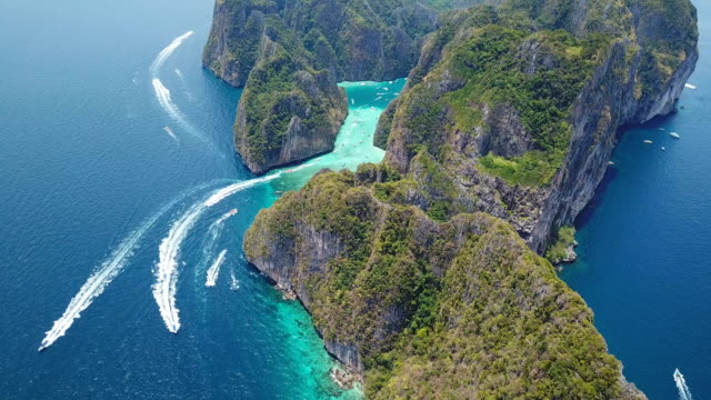 aerial drone view of tropical maya bay and limestone cliffs, phi phi islands, thailand - phi phi islands stock videos & royalty-free footage