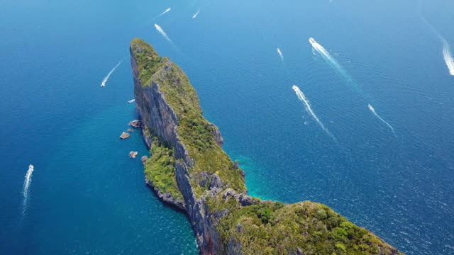 aerial drone view of tropical maya bay and limestone cliffs, phi phi islands, thailand - krabi province stock videos & royalty-free footage