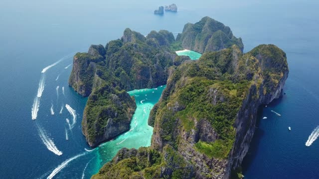 aerial drone view of tropical maya bay and limestone cliffs, phi phi islands, thailand - mayan stock videos & royalty-free footage