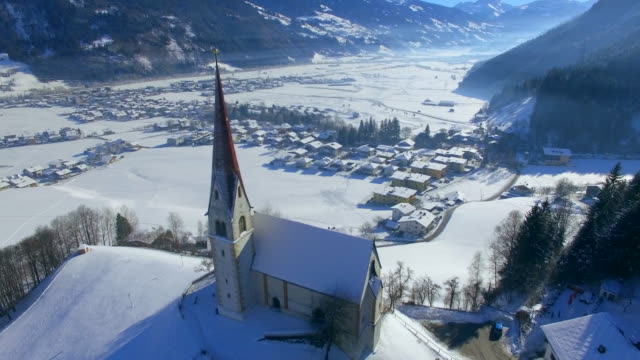 aerial drone view of uderns, austria and the pankrazkirche church. - austria stock videos & royalty-free footage