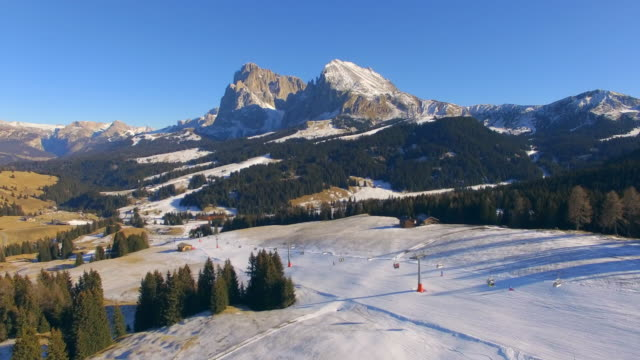 aerial drone view of val di funes and the geislerspitzen mountains in tyrol, austria. - austria stock videos & royalty-free footage