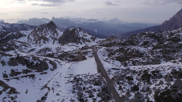 aerial drone view of valley and mountain range in winter - dolomiti video stock e b–roll