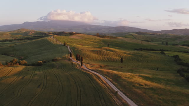 Aerial drone view of valley at sunset, Tuscany, Italy