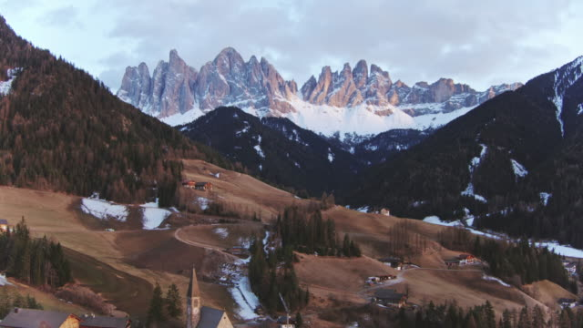 Aerial drone view of valley with mountain peaks, Dolomites, Italy