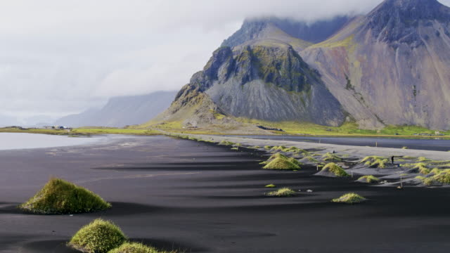 aerial drone view of vestrahorn mountain, stokksnes, iceland - moss stock videos & royalty-free footage