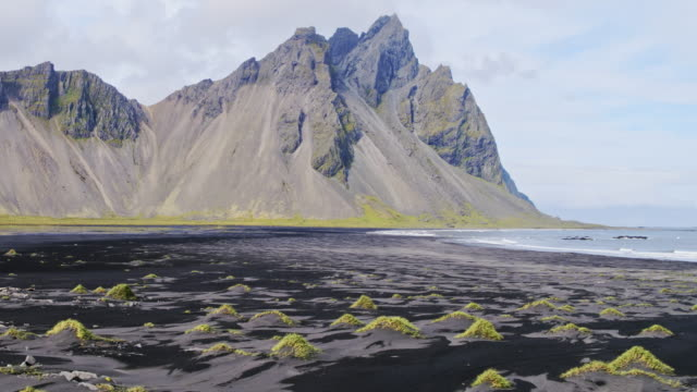 aerial drone view of vestrahorn mountain, stokksnes, iceland - dramatic landscape stock videos and b-roll footage