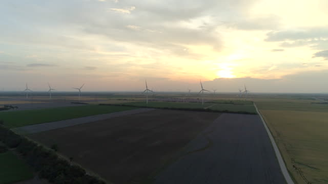 aerial drone view of wind turbine windmills at sunset. - slovakia stock videos & royalty-free footage