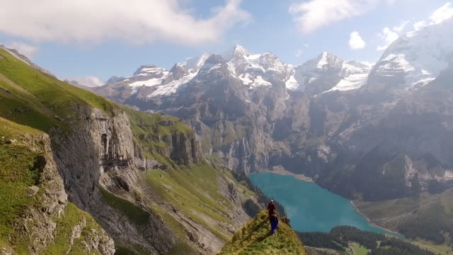 aerial drone view of wingsuit pilots walking to exit point - captain scarlet stock videos and b-roll footage