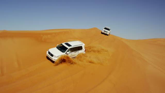 aerial drone view off road desert safari dubai - 4x4 stock videos and b-roll footage
